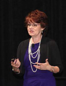 Kathleen speaking at CPCU - executive coach